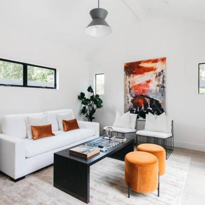 Contemporary small living room with orange accent