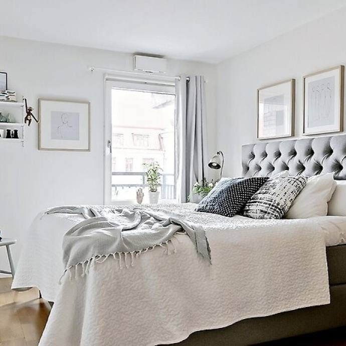 Tiny simple Scandinavian apartment bedroom