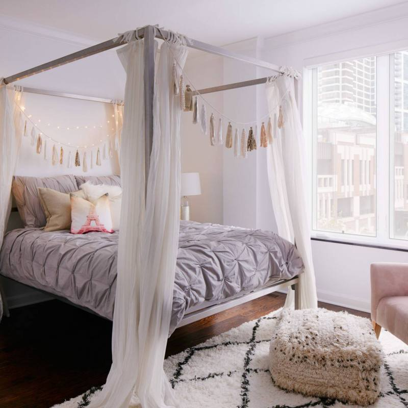 Romantic bohemian bedroom with canopy bed