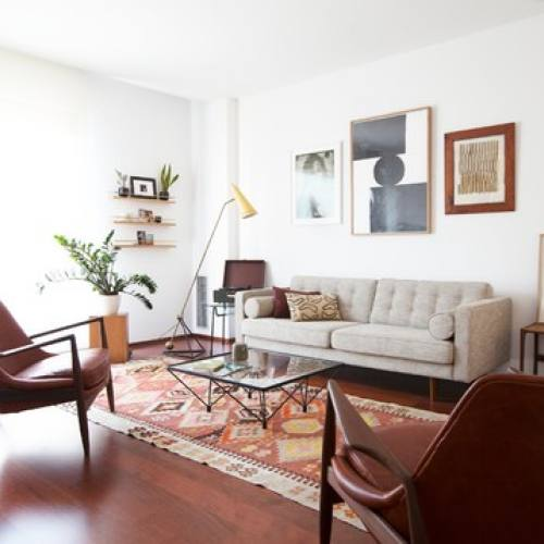 Mid century modern bohemian living room by A&B Curated