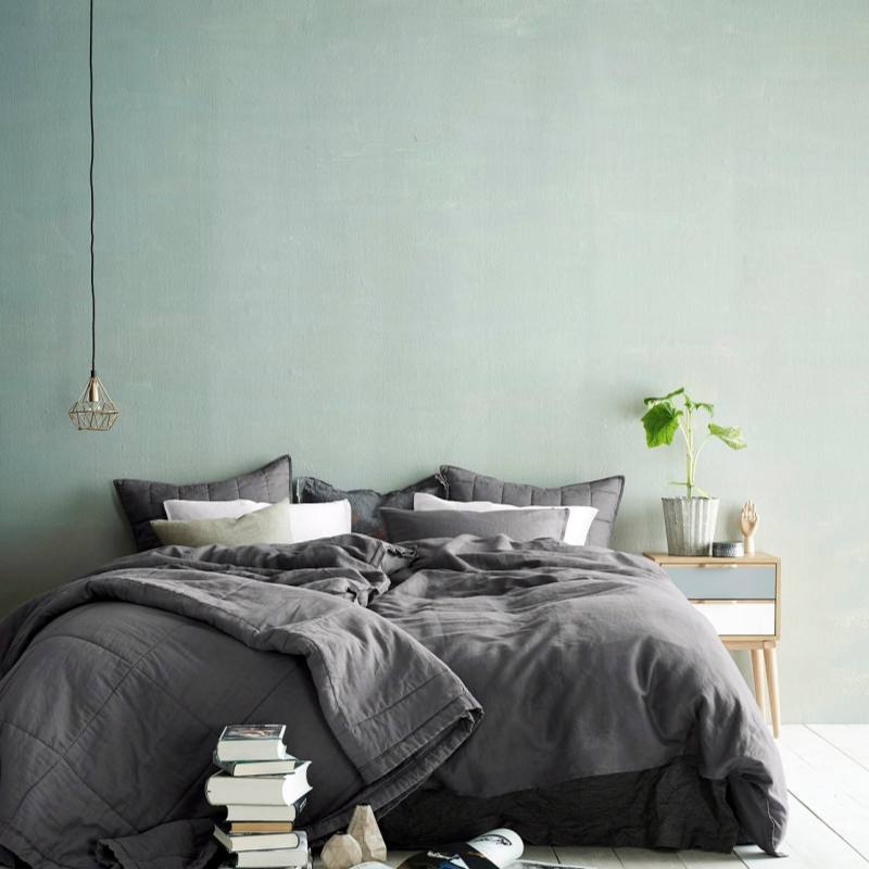 Minimalist Scandinavian Bedroom with sage green accent wall