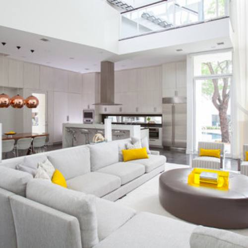 Modern minimalist grey living room with yellow accent