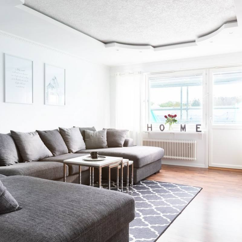 Ultra minimalist Scandinavian apartment living room with extra large grey sectional