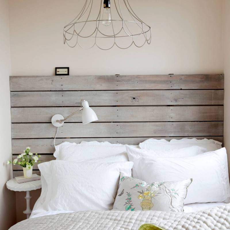 Small country farmhouse bedroom with shiplap headboard
