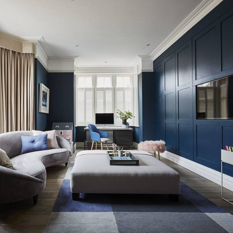 Contemporary living room with blue walls