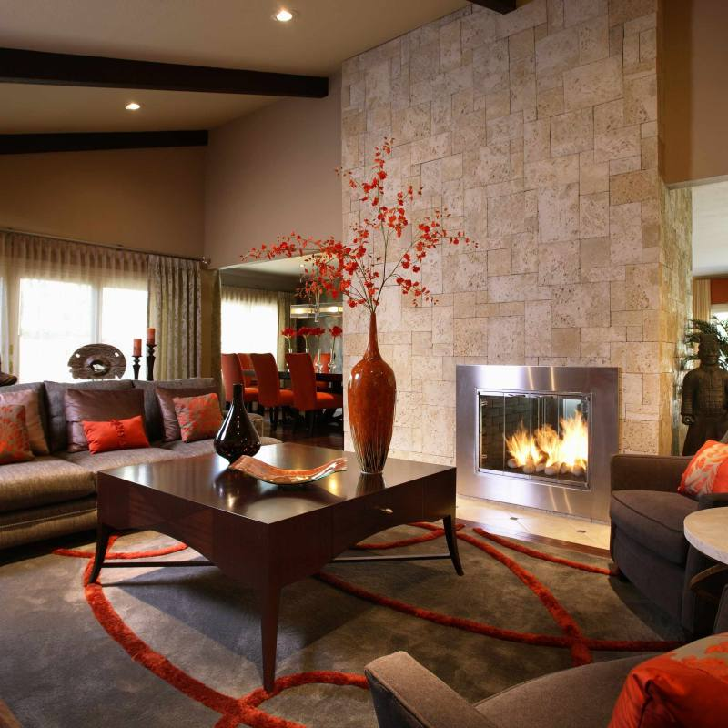 Dark transitional living room with red accents