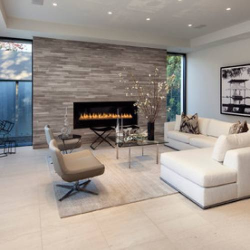 Modern fireplace wall living room by McClean Design