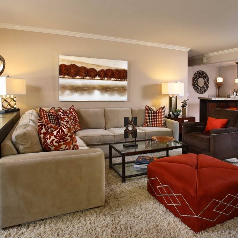 Neutral living room with red accents