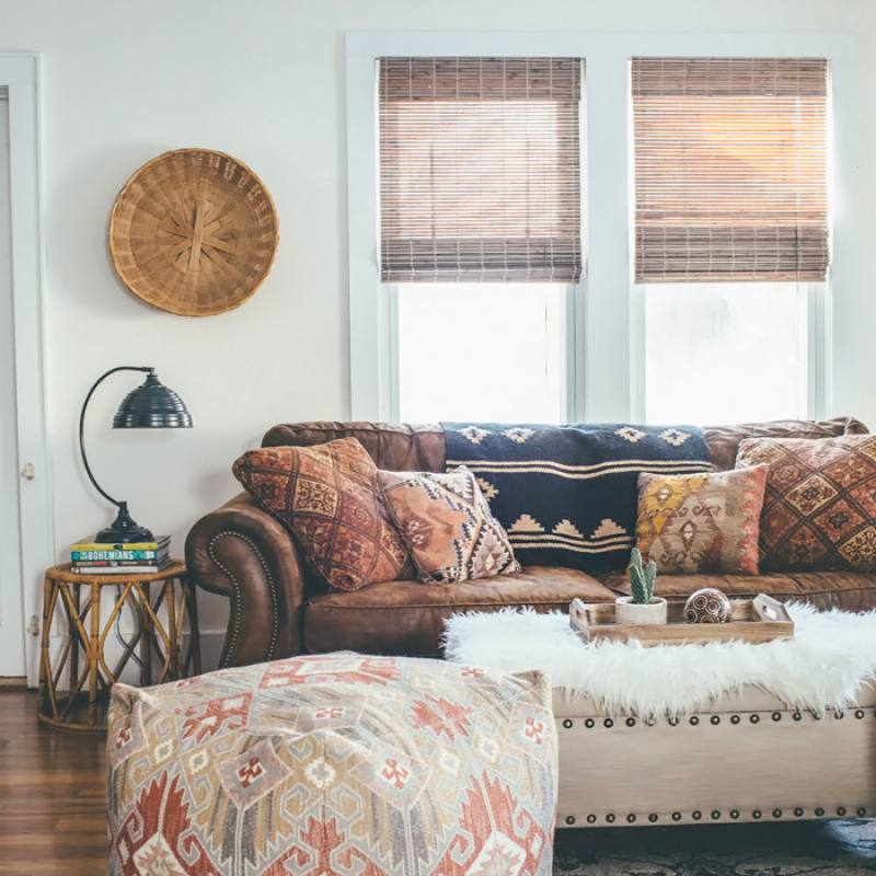 Vintage bohemian living room with rustic leather sofa