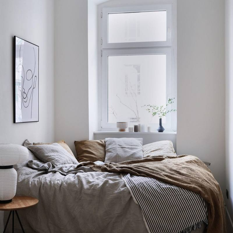 Casual small apartment bedroom