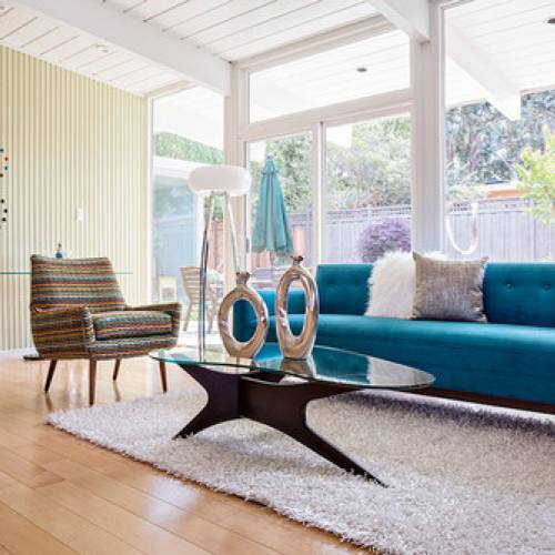 Mid century modern living room with blue couch by amyvogel