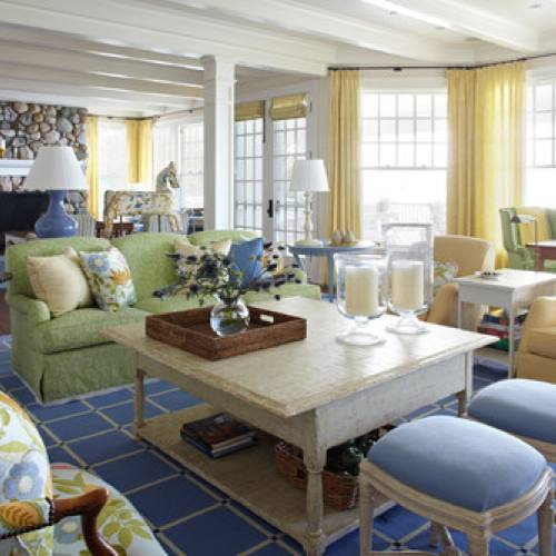 Colorful blue and yellow country style living room by Tom Stringer Design
