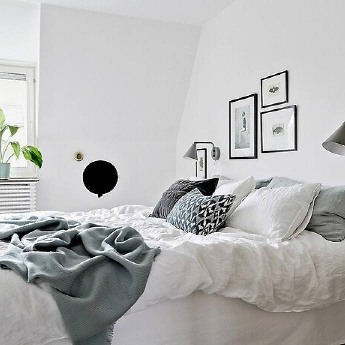 Cozy casual all white swedish bedroom