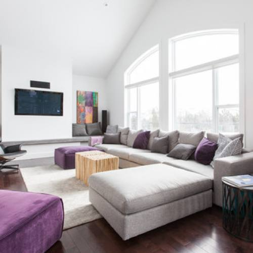Modern living room with purple accents