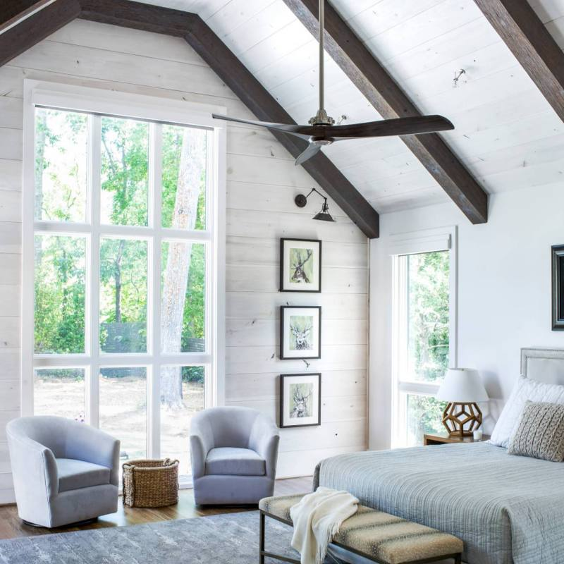 Modern farmhouse master bedroom with high ceilings