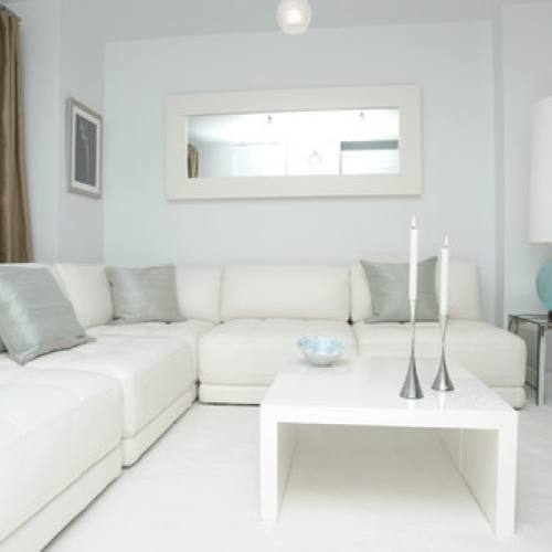 All white small contemporary living room