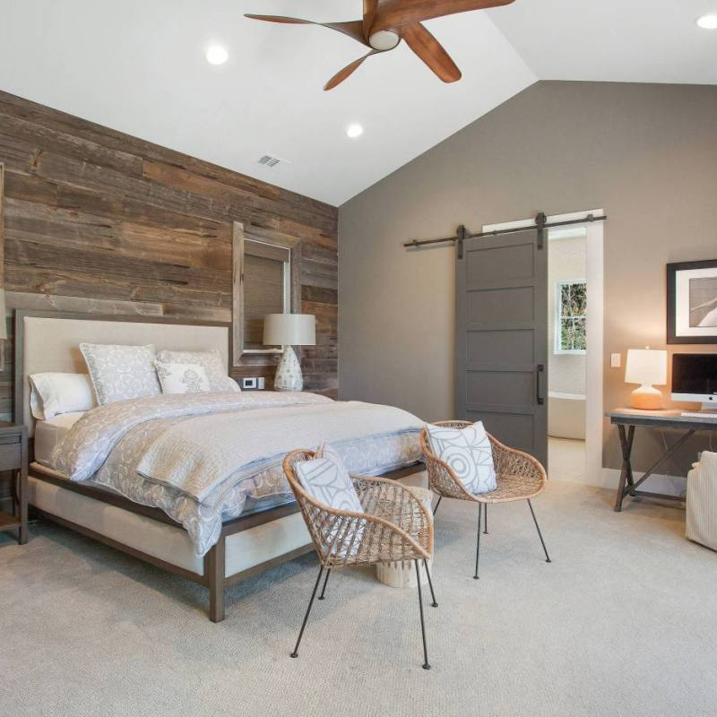 Rustic country bedroom with reclaimed wood shiplap wall