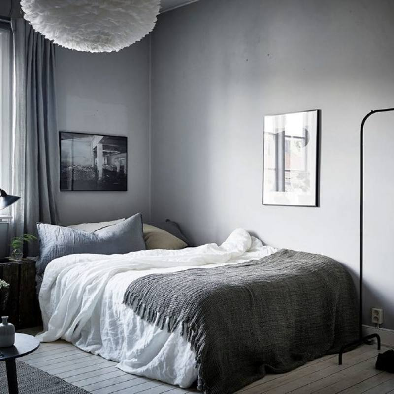 Dark moody casual apartment bedroom