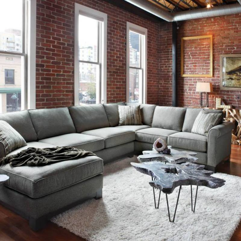 Rugged industrial bachelor pad with brick walls