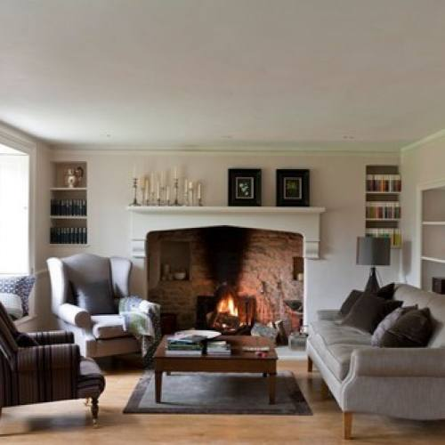 Traditional farmhouse inspired living room idea with fireplace