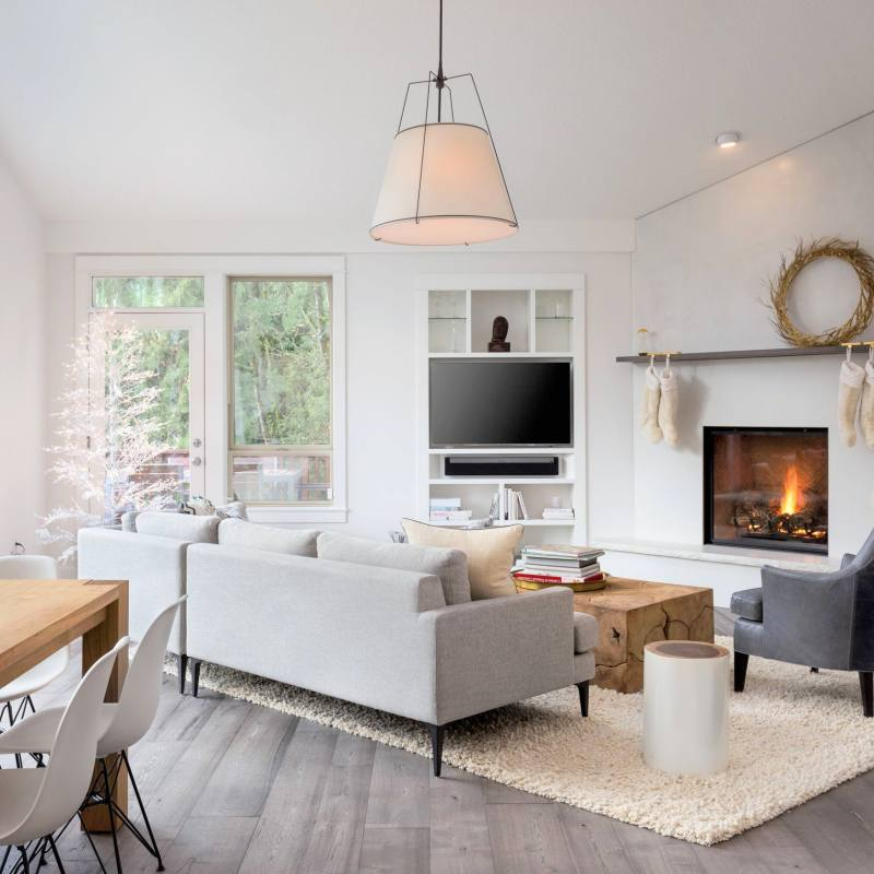 Chic modern farmhouse living room with neutral color palette and fireplace