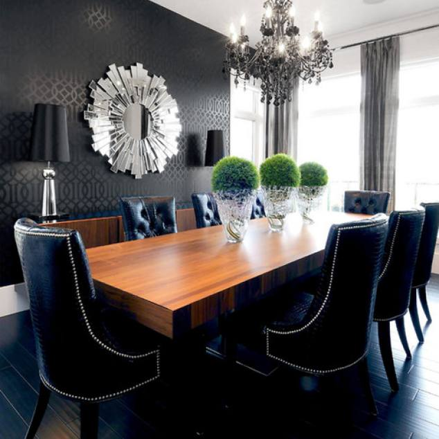 Dark transitional dining room with black accent wall by Atmosphere Interior Design