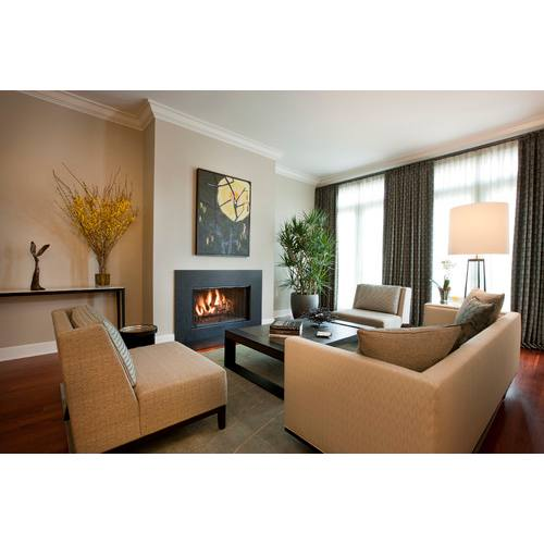 Modern fireplace wall living room with warm color palette by Michael Abrams Interior