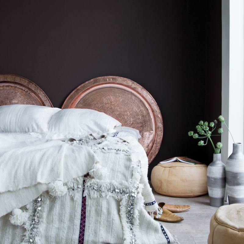 Scandi style boho chic bedroom with dark wall