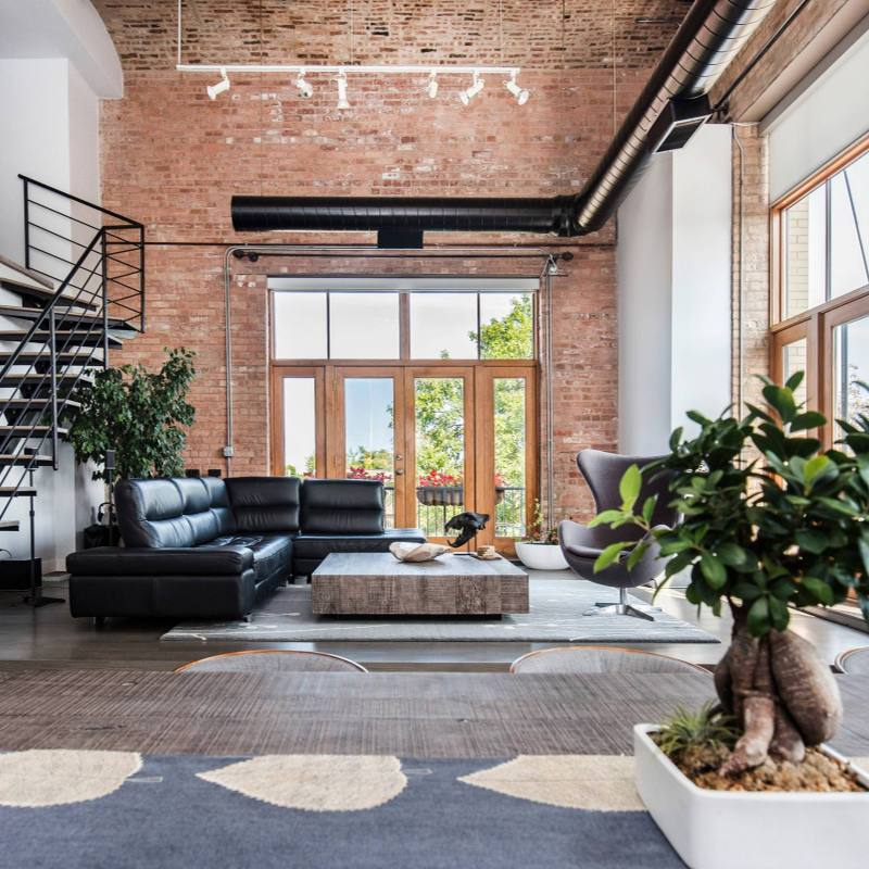 Modern industrial loft living room with exposed brick wall