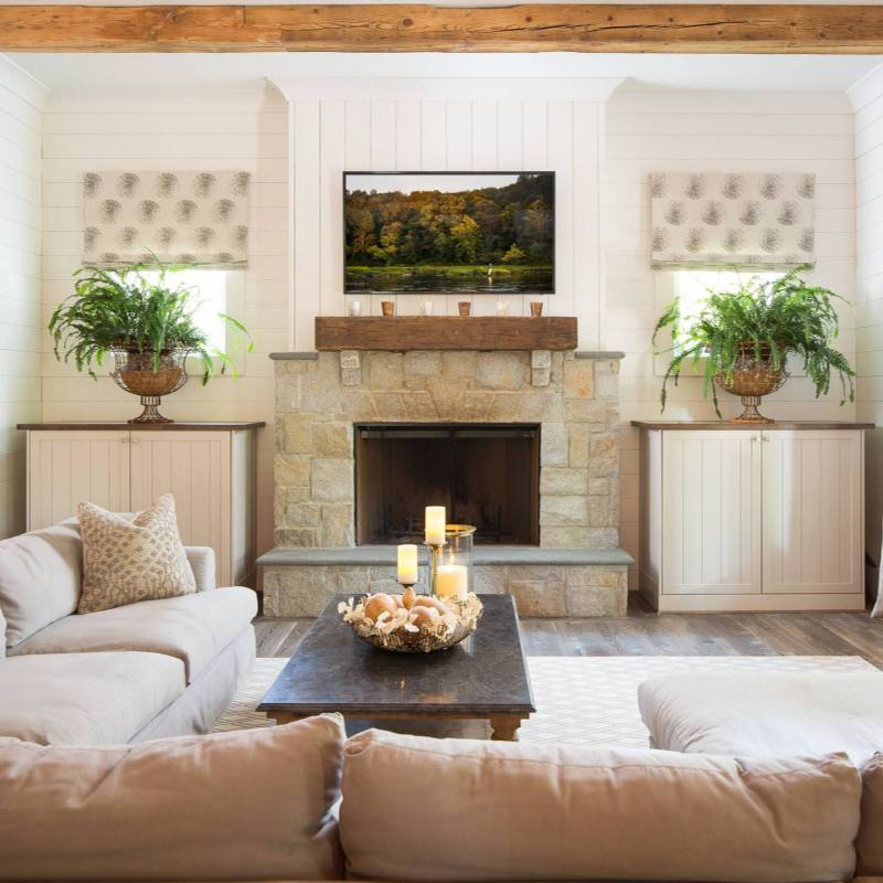 Neutral modern farmhouse with a fireplace