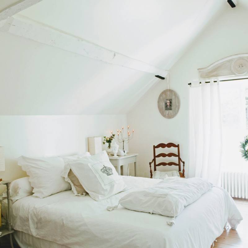 Vintage all white country style cottage bedroom