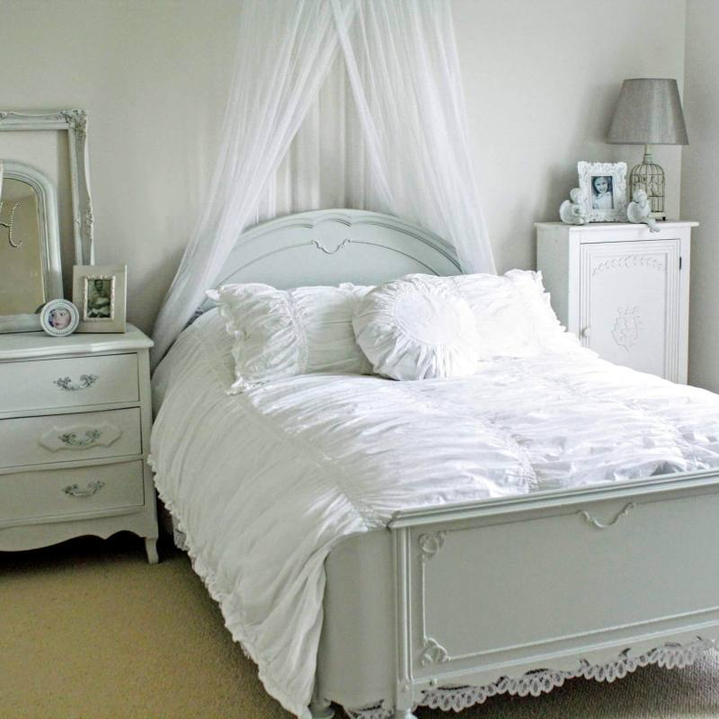 Cute cozy white country cottage bedroom