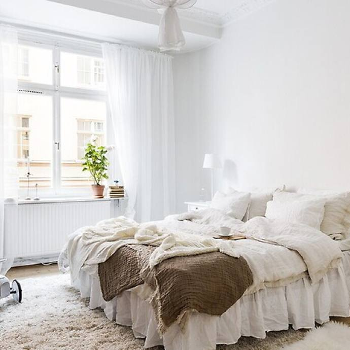 Cute cozy white Scandinavian Bedroom