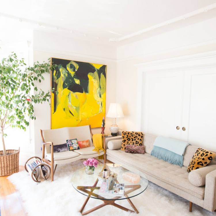 Bright colorful boho chic living room by Daphne Nauleau Interior