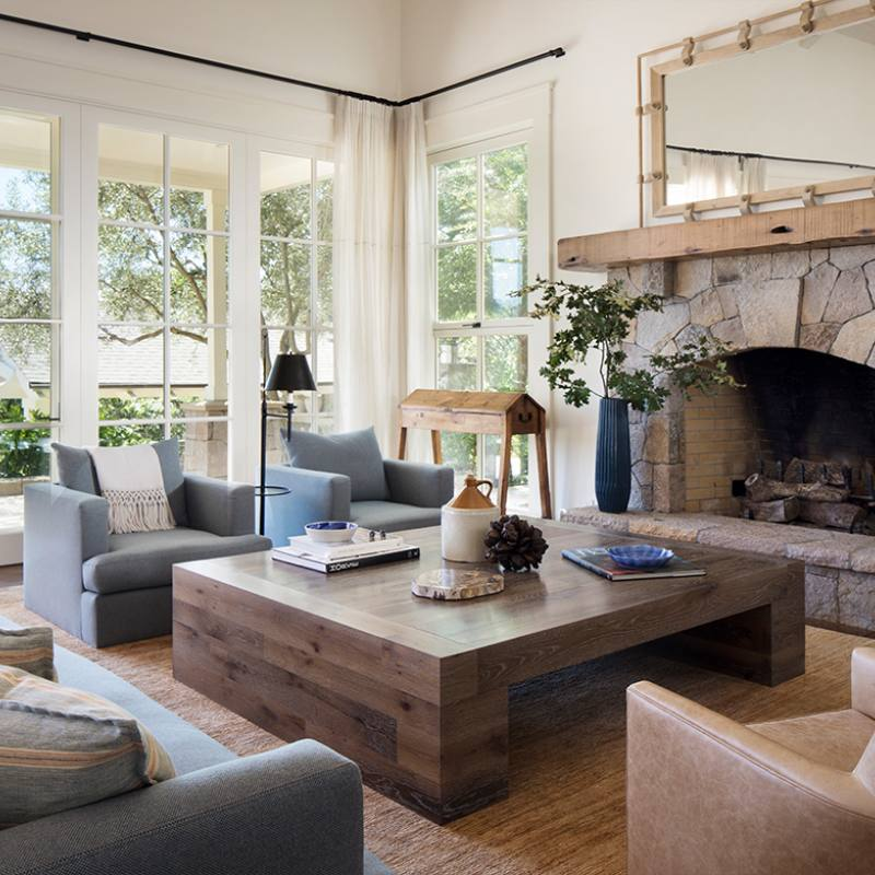 Modern farmhouse blue accent rustic living room with fireplace by j robin