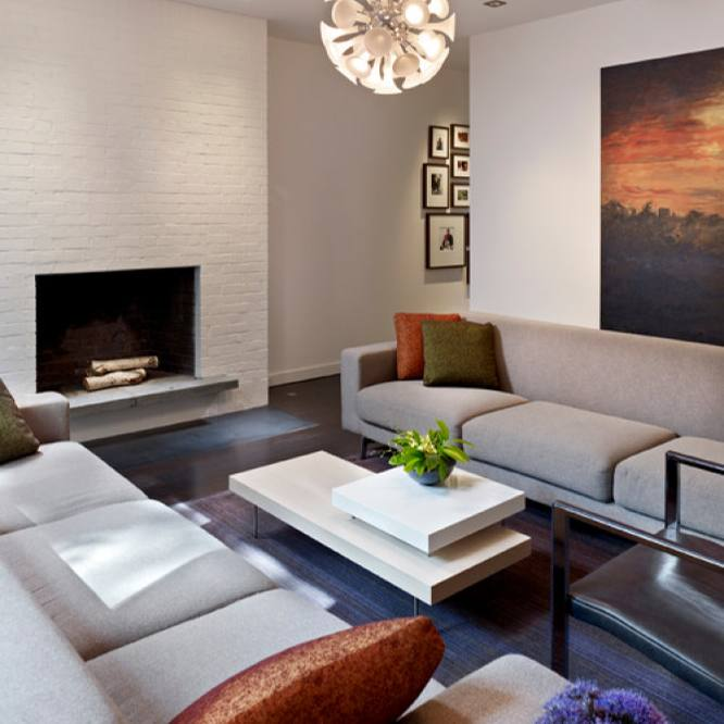 Modern living room with orange accent and fireplace