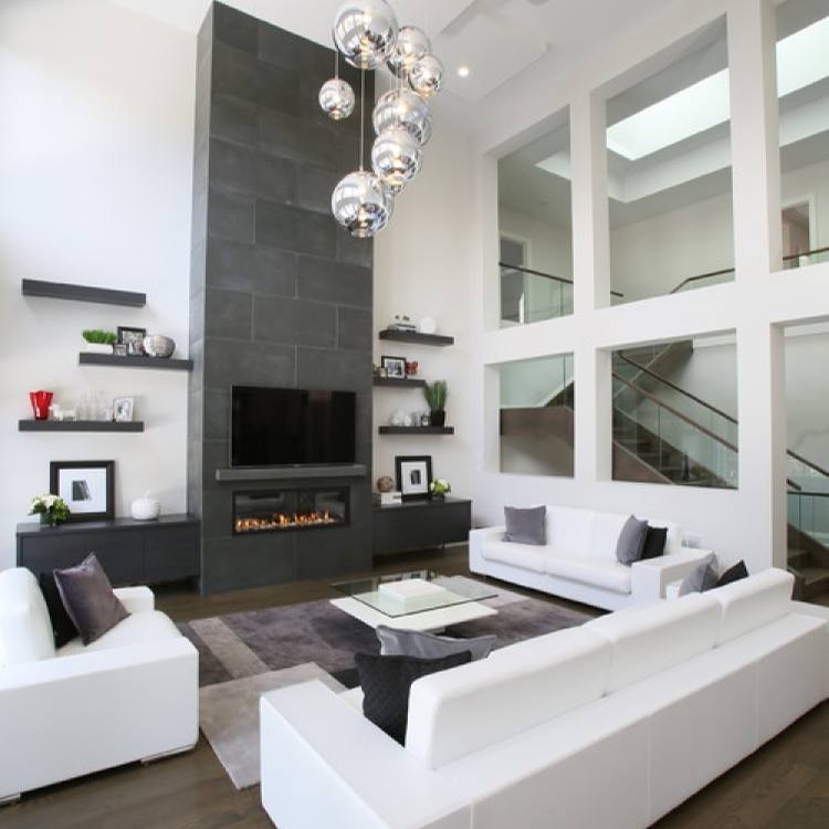 Contemporary sleek white large living room by Carey Mudford Interior