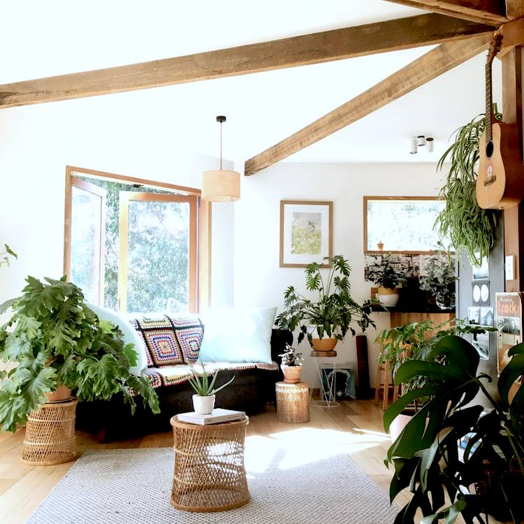 Boho loft living room with lots of plants