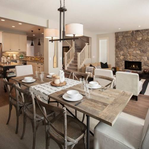 Rustic farmhouse dining room by Sabal Homes