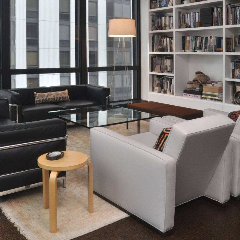 Get the look: Contemporary living room with black sofas
