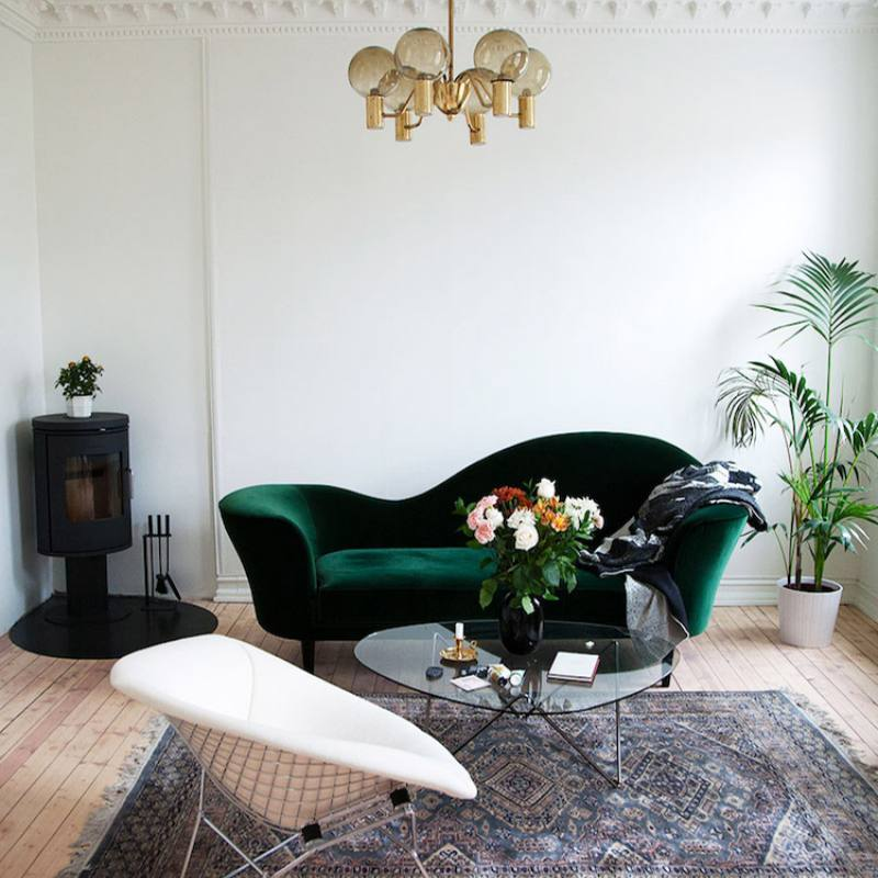 Small elegant nordic living room with green sofa
